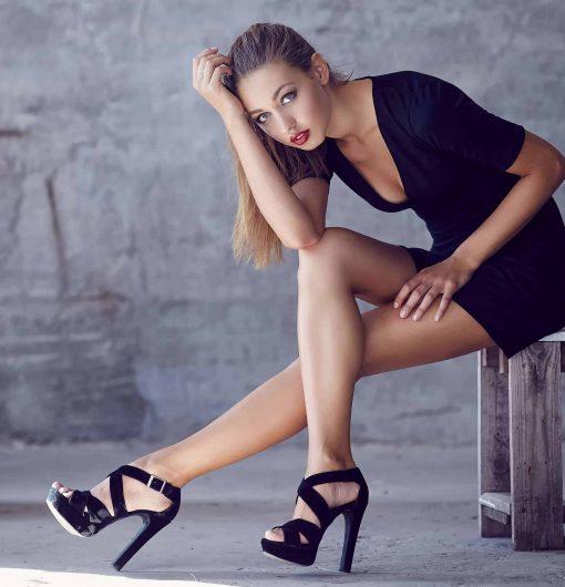 Slim woman in sexy black dress