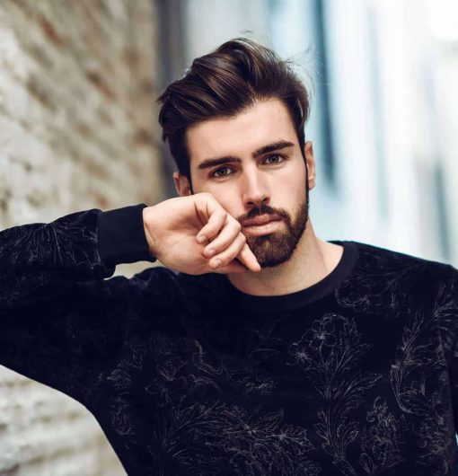Young bearded man model of fashion in urban